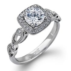 Simon G.18K White Gold Cushion Halo Vintage Style Floral Engagement Ring Featuring 0.15 Carats White Diamonds