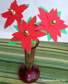 Printable poinsettia flowers craft. Easy holiday crafts for kids, pretty paper poinsettias from Activities for Kids. #Christmascrafts