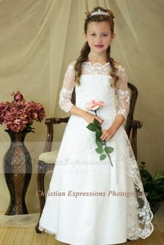 Classic style first communion dress with lace bodice and three quarter sleeves. This first communion gown is available exclusively through Christian Expressions. First Communion Veils, Girls Communion Dresses, First Communion Party, Baptism Dress, First Holy Communion, Girls Dresses, Flower Girl Dresses, Moda Formal, Maid Dress