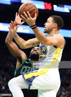 5669fab1eba Stephen Curry of the Golden State Warriors drives to the basket past Kyrie  Irving of the Boston Celtics in the first quarter of a game at TD Garden.
