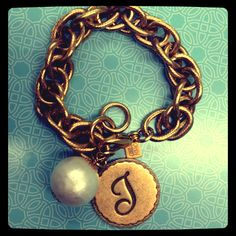 "Gold .  Initial ""T"" . Cotton Pearl . John Wind bracelet . My new favorite piece of  # arm candy ."