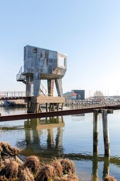 Gothenburg Public Sauna is raised up over the water in the city's Frihamnen port, and accessed via a wooden bridge.