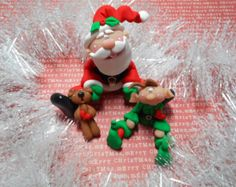 Polymer Clay Sitting Santa with His Sack filled by ClayBabiesInc