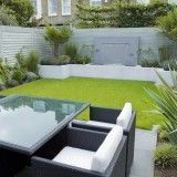 Concrete raised bed bordering lawn