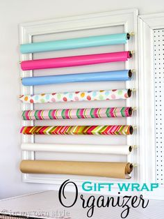 How to organize gift wrap.  It's a shame I don't have half a dozen open back frames collecting dust in the basement.  Oh wait...