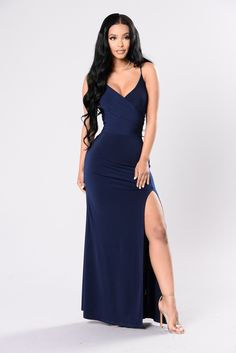 Available in Navy and Champagne Maxi Dress High Front Slit Surplice Top Deep Neckline Made in USA 95% Polyester 5% Spandex