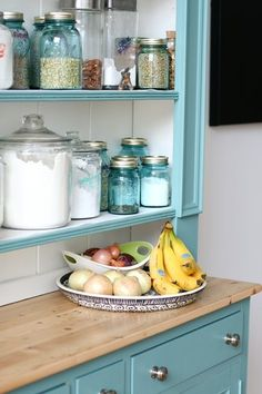 Colored mason jars for kitchen storage/display- notwithstanding the delightful aqua cabinet.