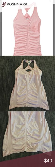 ATHLETA glow tank Shimmery light peachy/pink ATHLETA tank, built in bra for added support,  New with out tags never washed or worn. Athleta Tops Tank Tops