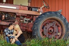 we did a shot like this for our engagement session.... now just to find another couple with a tractor!!