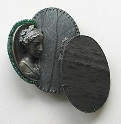 Brooch 2009   Photoetching/Zinc; Silver; cast Cameos; Emerald beads; Sapphire beads; Mother of Pearl
