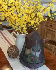 It's simple to add some spring to your home with some faux forsythia branches picked up at the dollar store.