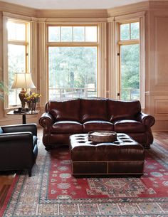 Old World living room Perfect rug complements leather chair