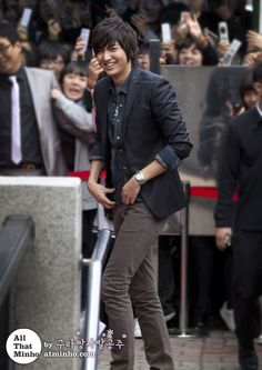 Lee Min Ho..even the guards holding back the hoards of screaming girls are smiling, cause of course it's LEE MIN HO