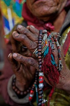A lama holds a mala, or Tibetan rosary, used to keep track of prayers and mantras in a ritual to foretell the future. He follows the religion of Bon, which predated Buddhism in ancient Tibet and is still practiced in a few areas of Mustang.