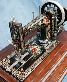 Vintage sewing machine. This is the most ornate beauty I've ever seen! (gaw)   A Bradbury High Arm Family Combination c. 1902                                                                                                                                                      More
