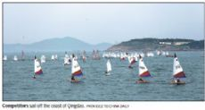 China's youth taking up sailing, encouraged by league competition, training in Qingdao.