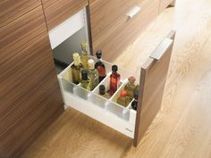Storage of cooking ingredients like oils, spices, herbs and sauces should all be contained in full extension drawers fitted with internal dividing systems