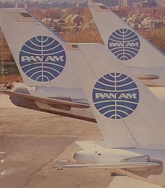 """""""Tall Tails,"""" A PanAm B 747SP, a B 747 and an Airbus A300 lined up at the New York, JFK hanger area. Circa 1985."""