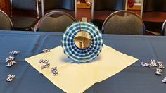 """Dollar Tree centerpieces ... Happy BD pinwheel decoration """"hacked"""" with a picture glued over the middle part originally depicted with """"Happy Birthday"""".  Trim the top hanger and set up in a Dollar Store wire easel.  Very inexpensive centerpiece that comes together in a snap."""