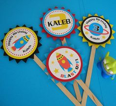 This adorable set of cupcake toppers will add a cute touch to any space theme party! This set of 12 personalized cupcake toppers also coordinates with my rocket ship invitation. Each topper measures 2.5 in diameter and is approximately 6 tall. They are layered with foam dots to give them added dimension and pop. When ordering be sure to convo me with your childs name and age. Thanks