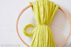 Easy Way to Make Giant Pom Poms using embroidery hoop vintagerevivals.com