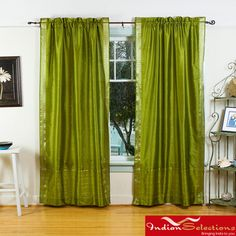 @Overstock - Add splendor to any room in your home with these rod pocket sari sheer curtains from India. These olive green handmade drapes are heavily bordered with excellent artwork.  http://www.overstock.com/Worldstock-Fair-Trade/Olive-Green-Sheer-Sari-84-inch-Rod-Pocket-Curtain-Panels-India/6155730/product.html?CID=214117 $56.99