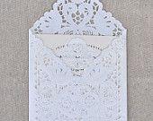 25 PIECE SET Lace Wedding Invitation Envelope Liner, Paper Doily Lace Invitation Liner, Embellishment, Invitation Envelope. $43.50, via Etsy.