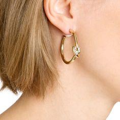 Золотистые серьги-кольца с узлом