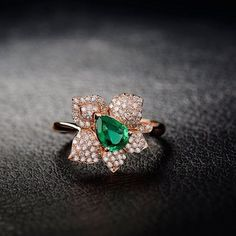#Amazon.com: Women's Solid 14K Rose Gold Pear Emerald Diamond wedding ring: Clothing
