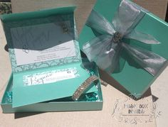 "Boxed invitations with a special treat - bracelet inside! Give your guests a gift! But that's not all; this Tiffany and Co. blue turquoise and silver invite plays MUSIC when it is opened...a great song choice for this one is ""Moon River""."