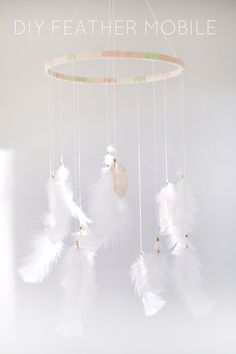 DIY Feather Mobile / made one similar to this and added a layer of pastel feathers and made strings longer. So dreamy!
