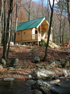a tiny cabin by a stream = bliss We could build this for the kids to play in on the lower lot in Wisconsin?  Bob, did you hear me?