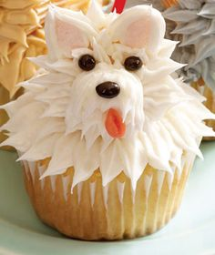 Terrier Cupcake. Pipe brown or gray icing through the tip of a plastic bag in a swirly pattern to make a furry face. Use a marshmallow for the pup's snout, a dark jelly bean for the nose, and M for the eyes. To make ears, cut marshmallows on the diagonal and dip the sticky side in pink sugar. Cut a sliver of pink Starburst for the tongue.