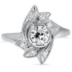 The Ize Ring-Unusual yet except for the big diamond in the middle..it would be beautiful