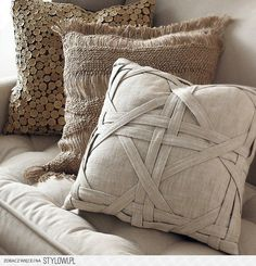 Love the detailing on the beige pillow.....