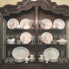 china & crystal in china cabinet/hutch. I had a hard time finding good examples of how to arrange/display china & crystal. I'm not a professional (or a perfectionist; see crooked plate in photo) but I like how it turned out!
