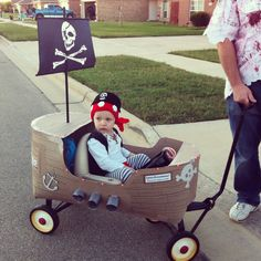 My little candy pirate on Halloween - crochet pirate hat and sash, semi-homemade pirate costume, and pirate ship built on little red wagon