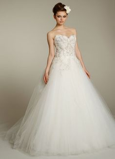 LZ31512    Ivory tulle bridal ball gown, strapless curved neckline, sheer alencon lace bodice with beaded and embroidered overlay cascading down skirt, dropped waist, gathered tulle skirt, chapel train.
