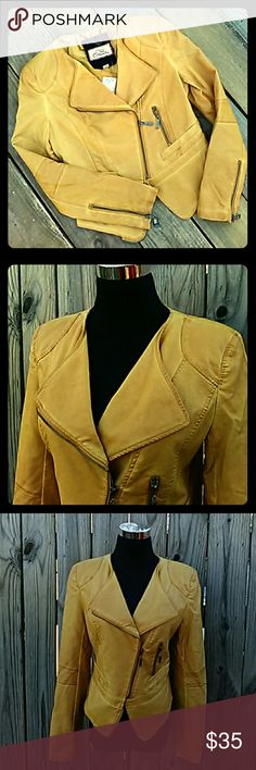 One Community Moto Jacket Beautiful mustard yellow faux leather jacket. Animal print faux leather on shoulders and arms. Deep V neckline. Polyester lining. Zippers at the wrist. One Community Jackets & Coats