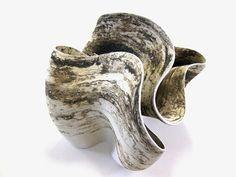 Memories, Ceramic on wooden surface,  115 x 46 x 12 cm     Desire to roll, Ceramic on wooden surface,  120 x 42 x 13 cm ...