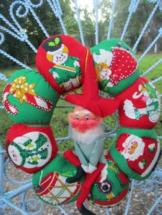 vintage fabric Christmas wreath with knee hugger elf pixie doll