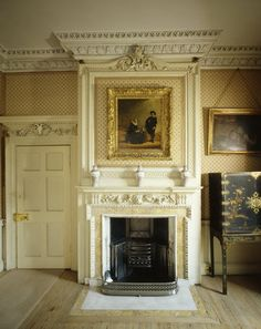 Morning Room at Peckover House showing the 18th century carved marble mantle with picture above it. Peckover House is a classic Georgian merchant's home