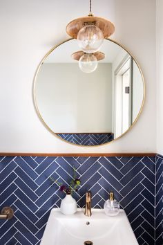 Blue bathroom tiles in a herringbone pattern playfully pairs classic and contemporary style in at this Napa Valley winery. Metro Tiles Bathroom, Bathroom Floor Tiles, Bathroom Tile Patterns, White Bathroom Tiles, Upstairs Bathrooms, Small Bathroom, Blue Bathroom Mirrors, Bathroom Storage, Bathroom Ideas