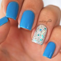 Blue manicure with silver white stamped accent nail. Blue nails. Glitter nails