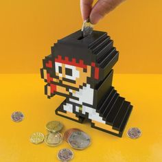 Street Fighter Ryu Money Box / A tough fight awaits for those who's got an eye on your hard earned coins as Street Fighter Ryu Money Box comes into view. http://thegadgetflow.com/portfolio/street-fighter-ryu-money-box/