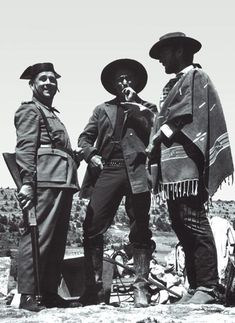 "Clint Eastwood in the company of a Spanish policeman during the shooting of ""The Good, The Bad, and The Ugly."""