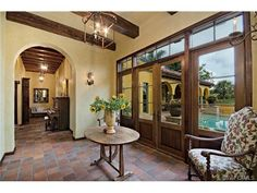 Colliers Reserve | Mediterranean hallway - breeze way - french doors - lanterns - terra cotta tile floors.  Naples, Florida