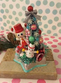 Christmas Jello Mold Decoration ~ Vintage Ornaments, Bottle Brush Tree, Candy Cane, Kitschy Christmas Assemblage, Retro Holiday Cake Topper This is a funky fun, festive little Christmas assemblage piece. It is colorful and charming! Base is made with a vintage metal star Jello mold