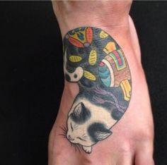 Coloured cute sleeping cat tattoo on foot - Tattooimages.biz