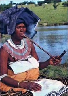 xhosa lady smoking traditional pipe and wearing traditional clothing - 1968 postcard Xhosa Attire, Body Painting Festival, East Cape, African Wear, African Style, Tribal Women, African Tribes, Out Of Africa, Women Smoking